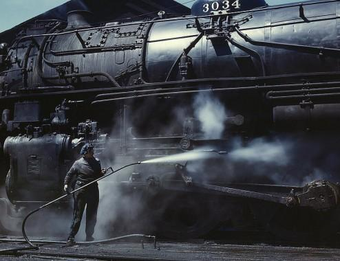 Jack Delano, Mrs. Viola Sievers, one of the wipers at the roundhouse giving a giant H class locomotive a bath of live steam, Clinton, 1943