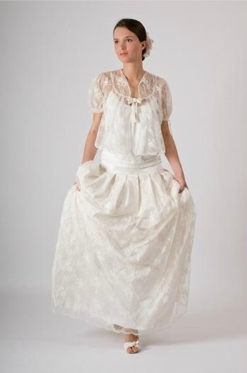... chez Dior) avant de monter sa propre ligne de robes de mariées