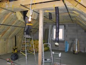 Aménager ses combles : Isolation de sous-toiture avec des panneaux de laine Isover Isoconfort 35 200MM