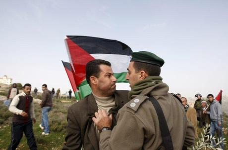 877611_a-palestinian-activist-argues-with-israeli-border-police-officer-during-a-protest-near-ramallah.jpg