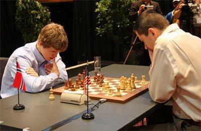 le choc du jour Onischuk - Carlsen ou le remake de la finale 2007 - photo Chessbase