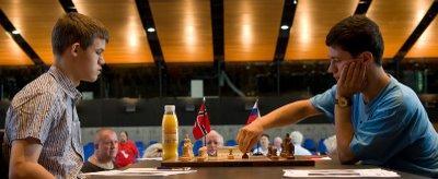 Magnus Carlsen - Evgeny Alekseev - photo Olivier Breisacher