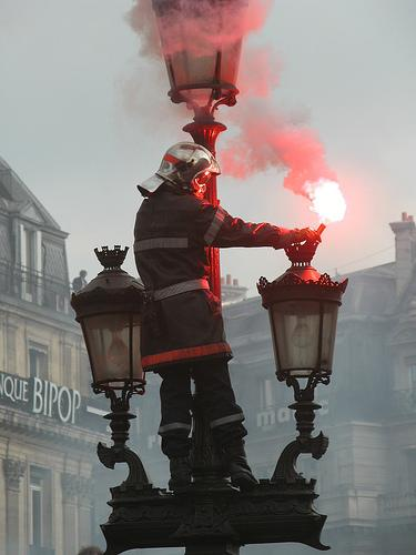 Paris fireman in middle of demonstration