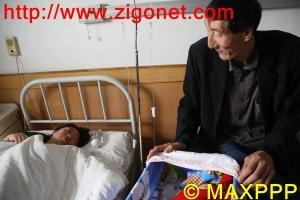 Bao Xishun, sa femme, et leur petit garçon