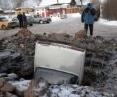 accident voiture trou