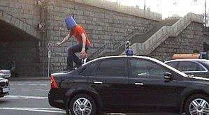 crazy_man_in_blue_pail_jumps_on_car_04.jpg