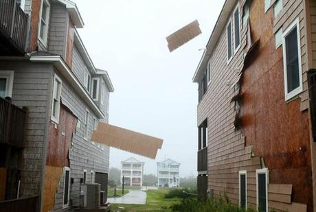 The hurricane-force winds of Irene rip the siding off of homes in Nags Head, N.C.