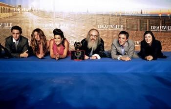 US Director Tony Kaye (4rthL) celebrates with revelation jury members, French actor Benjamin Siksou (1stL), French actress Elisa Sednaoui (2ndL), French actress Sabrina Ouazani (3rdL), French screenwriter Samuel Benchetrit (2ndR) and Iranian actress Leila Hatami (1stR) after winning the Revelation prize and the International critic's prize at the 37th American Film Festival, in Deauville, northwestern France, on September 10, 2011.