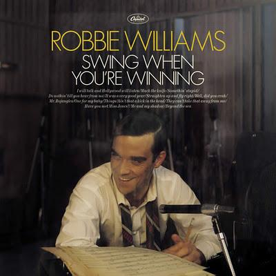 MUSIC MINUTE : ROBBIE WILLIAMS. BECAUSE THERE'S ONLY ONE ROBBIE.