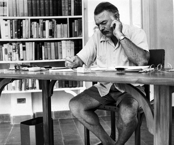 Hemingway_at_his_writing_desk.