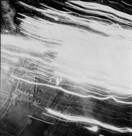 An-aerial-photograph-of-a-bombing-raid-on-Cologne-1942-the-streaks-are-the-tracks-of-searchlights-and-tracer-bullets-from-anti-aircraft-fire