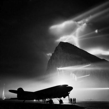 A-Douglas-Dakota-of-the-British-Overseas-Airways-Corporation-at-Gibraltar-silhouetted-by-searchlights-on-the-Rock-1940-45