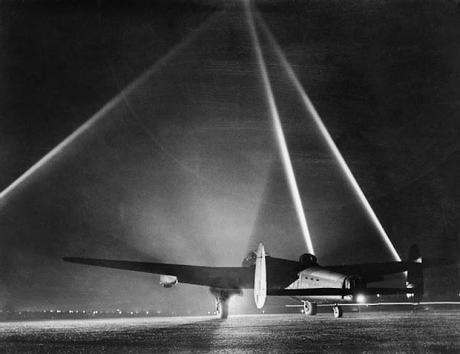 An-Avro-Lancaster-on-the-runway-before-taking-off-for-an-air-raid-with-searchlights-indicating-the-height-of-the-cloud-base-1943
