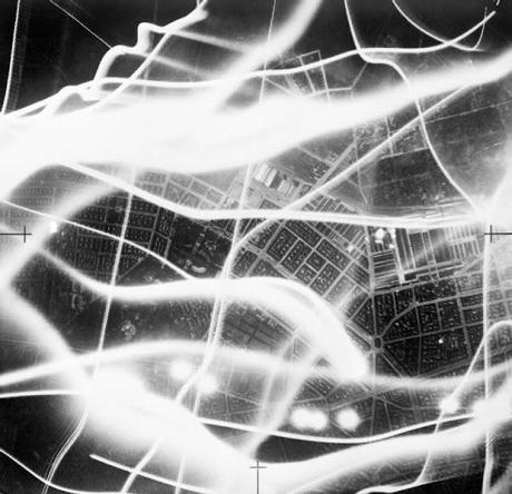 An-aerial-photograph-taken-during-an-air-raid-on-Berlin-with-the-wavy-lines-of-searchlights-and-anti-aircraft-fire-1941