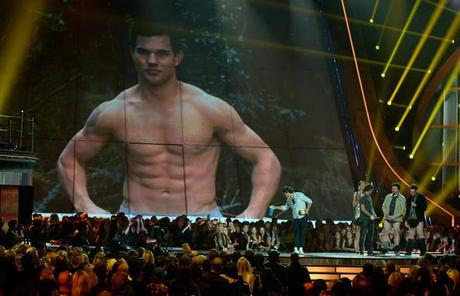Taylor Lautner Actor Taylor Lautner accepts Best Shirtless Performance onstage during the 2013 MTV Movie Awards at Sony Pictures Studios on April 14, 2013 in Culver City, California.