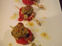 Escargot dans sa tomate cerise
