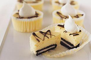 OREO Mini Cheesecakes Prep Time: 10 mins.   Bake time: 20 mins.   Total time: 4 hrs. 30 mins.   Ingredients: 2 pkg. (250g each) Philadelphia brick cream cheese, softened 1/2 cup sugar 2 eggs 12 Oreo Cookies 3 squares Baker's semi-sweet chocolate 1 cup thawed Cool Whip whipped topping