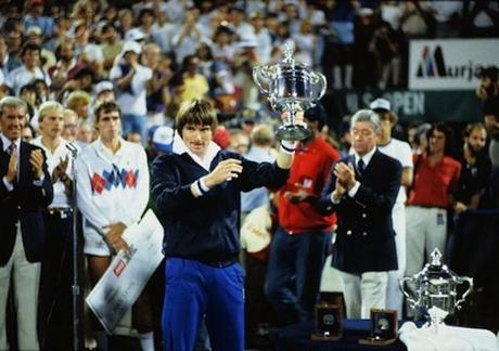 Jimmy Connors Gesturing with His Open Cup Trophy