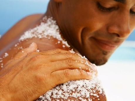 Hand Rubbing Bath Salt on Man's Shoulder
