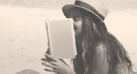 Reading at the beach gif