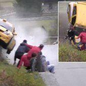 Rally fans cheat death by inches as vehicle flips over them