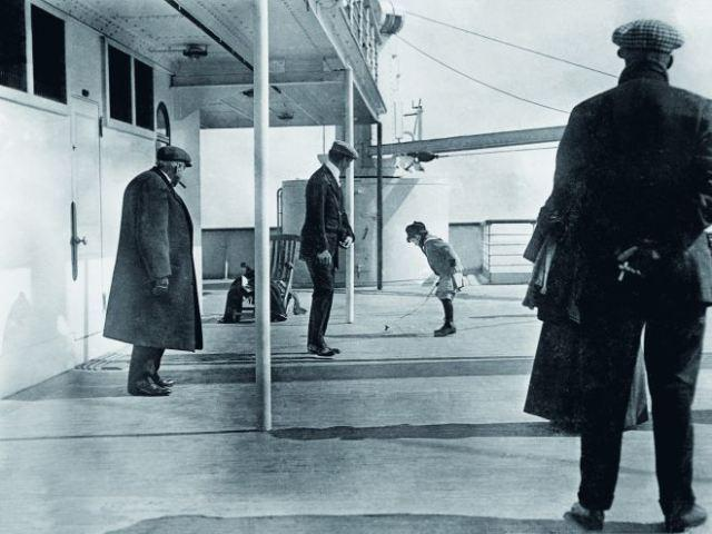 A boy plays aboard the deck of the Titanic