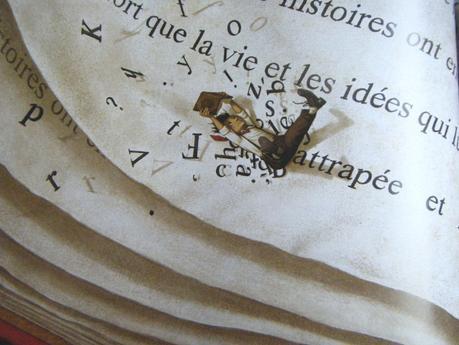 Morris qui tient un livre vogue sur un autre livre dans mon livre ... Je vous avais dit que c'était inception !