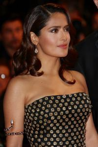 CANNES, FRANCE - MAY 14:  Salma Hayek Pinault wears aPre SS13 Black & gold embroidered silk organza bustier gown and Diamond Bridge box clutch by Alexander McQueen and jewels by Boucheron attending the Premiere of