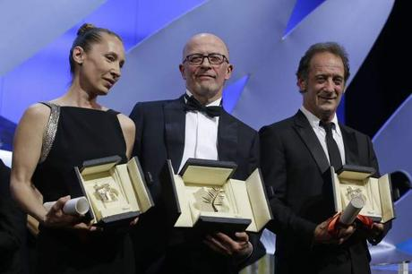 Director Jacques Audiard, center, holds the Palme d'Or award for his film Dheepan, alongside actress Emmanuelle Bercot holding the Best Actress award for the film Mon Roi, left, and actor Vincent Lindon with the Best Actor award for the film The Measure of a Man, during the awards ceremony at the 68th international film festival, Cannes, southern France, Sunday, May 24, 2015. (AP Photo/Lionel Cironneau)/XCAN172/286060530072/1505242040