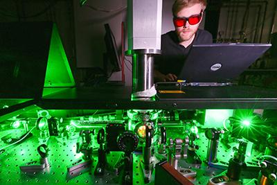 Photograph of the 2D ultrafast, ultraviolet spectroscopy set-up that was used to measure the spin crossover time