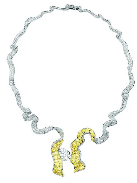 COLLIER DÉNOUÉ DIAMANT 750/1000e or blanc et jaune, diamants, et diamants jaunes
