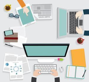 Realistic workplace organization. Top view with textured table, computer, smartphone, graphic tablet, note paper, glasses, newspaper, diary and coffee mug.