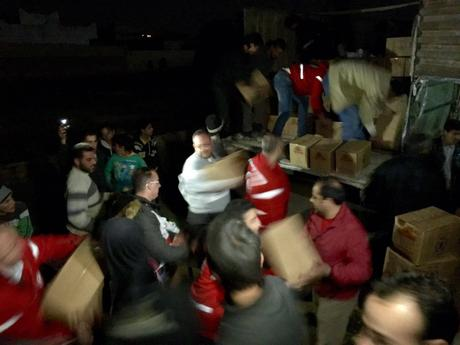 Boxes of aid are delivered at night as a joint convoy of the International Committee of the Red Cross (ICRC), the Syrian Arab Red Crescent (SARC) and the United Nations yesterday reached several villages in the region of Al Houleh, north of Homs. The convoy brought food, medicine and water supply equipment for more than 70,000 people. Majda Flihi/ICRC