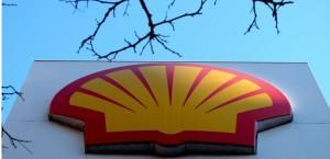 The Shell logo at a petrol station in London, Wednesday, Jan. 20, 2016. Royal Dutch Shell expects its fourth quarter profits to drop by at least 40 percent to between $1.6 billion and $1.9 billion after a sharp drop in crude oil prices, but underscored its determination to press ahead with the proposed mega-merger with BG Group plc. (AP Photo/Kirsty Wigglesworth)/LKW101/906012064483/1601201425
