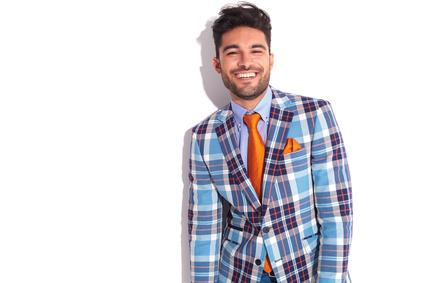 Casual man in plaid jacket and orange tie_105611212_XS