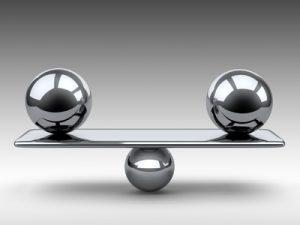 Balance between two large metallic spheres.