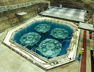 Photograph of four of the Daya Bay antineutrino detectors