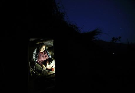 Dhuna Devi Saud prepares to sleep inside the ?Chaupadi? shed in the hills of Legudsen Village at Achham District