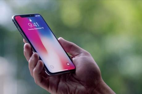 Image result for holding iphone X