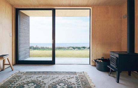 cabane muji vitres poele tapis vue mer