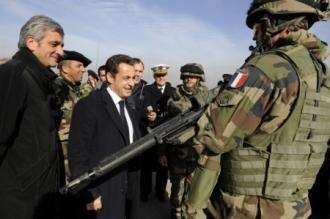 Hervé Morin et Nicolas Sarkozy en visite auprès des soldats français en Afghanistan, en décembre dernier