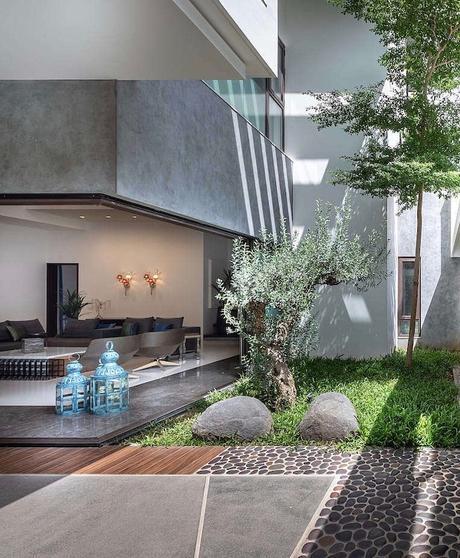 villa tropicale style loft façade terrasse beton - blog déco - clem around the corner