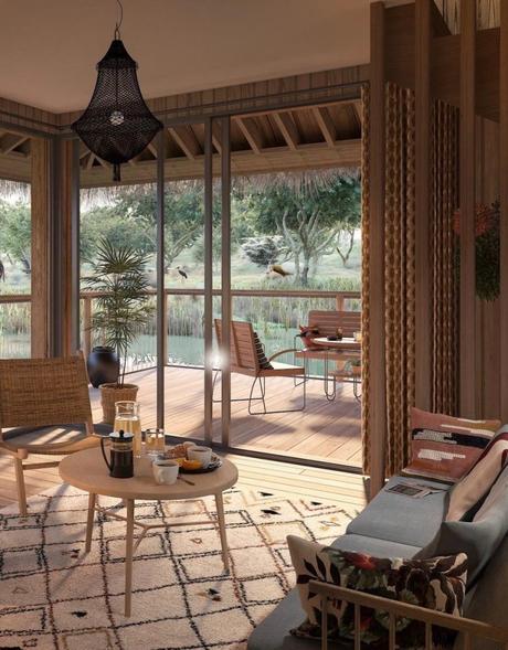 lodge maison sur pilotis dans un lac vue sur les animaux sauvage faune et flore africaine clematc