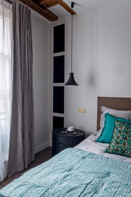 meubler un 60m2 à Paris chambre design rustique poutres apparentes