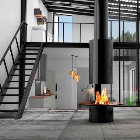 cheminée centrale mezzanine cuisine ouverte escalier métal - clemaroundthecorner