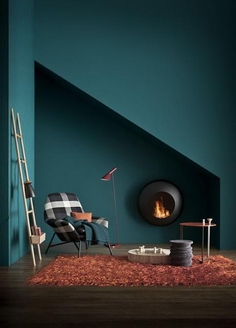 chambre salon déco moderne tendance bleu tapis cuivré poêle