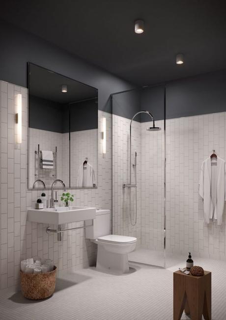 salle de bain retro noire et blanche  minimaliste tabouret en bois carrelage mosaique