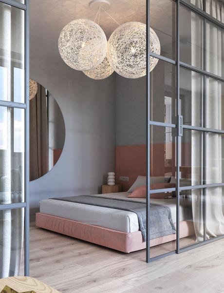 chambre parentale lit double gris rose pâle miroir rond porte vitrée