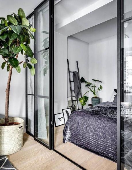 chambre lit double déco plante verte inspiration pièce sans fenêtres