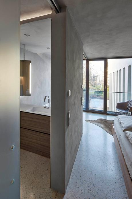 suite parentale sobre élégante mur béton gris clair meuble bois néon lumineux